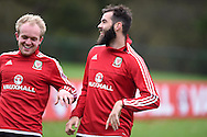 Joe Ledley of Wales ® jokes with Jonathan Williams  during the Wales football team training at Hensol Castle, Vale of Glamorgan, South Wales on Tuesday 10th November 2015. the team are training ahead of their friendly against the Netherlands on Friday,<br /> pic by  Andrew Orchard, Andrew Orchard sports photography.