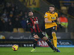 Wolverhampton Wanderers' Matt Doherty (right) and Bournemouth's Diego Rico battle for the ball
