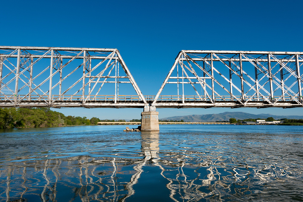 Licensing - Open Edition Prints<br /> Railroad bridge spans the Snake River in Burley Idaho on a summer day