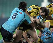Conrad Smith pushes off Dave Dennis. Waratahs v Hurricanes. 2012 Super Rugby round 15 match. Allianz Stadium, Sydney Australia on Saturday 2 June 2012. Photo: Clay Cross / photosport.co.nz