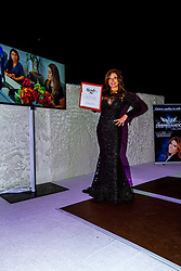 LOS ANGELES, CA - JUN 3: Adriana Gallardo display the State Senate Recognition Certificate at the Despegando Show VIP Launch party at Don Chente's Restaurant in downtown Los Angeles. The reality show is presented by Adriana Gallardo, founder and CEO of Adriana's Insurance. The show will coach chosen participants how to be successful entrepreneurs. 2015, June 3. Byline, credit, TV usage, web usage or linkback must read SILVEXPHOTO.COM. Failure to byline correctly will incur double the agreed fee. Tel: +1 714 504 6870.