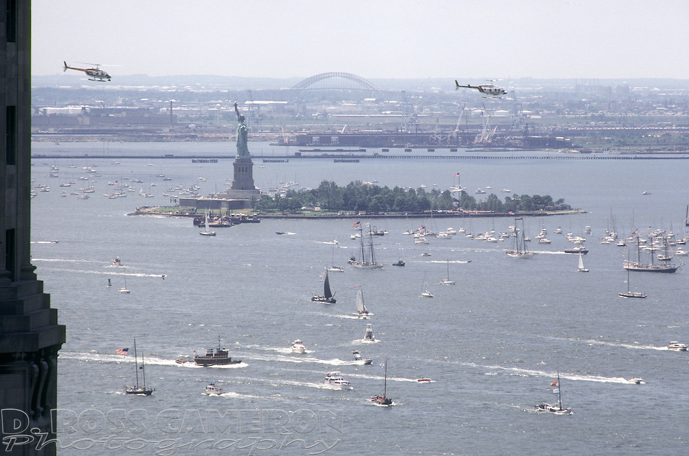 Helicopters fly by the Statue of Liberty during its centennial celebration, Friday, July 4, 1986, in New York. (Photo by D. Ross Cameron)