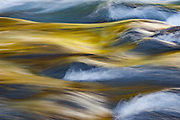 Afternoon light catches moving water near Haast Pass, West Coast, New Zealand.