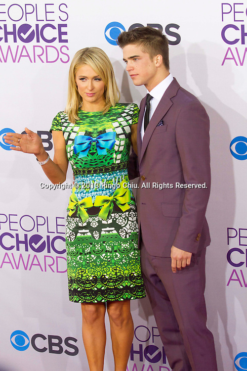 Paris Hilton and River Viiperi arrive at the 39th Annual People's Choice Awards at Nokia Theatre L.A. Live on Wednesday January 9, 2013 in Los Angeles, California, United States. (Photo by Ringo Chiu/PHOTOFORMULA.com)