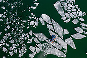 A Coast Guard airboat conducts training on the broken up ice on the bay of Green Bay in Door County, Wisconsin.