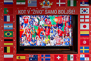 The Portuguese football fans are shown on a street TV screen bordered by international flags before their game with Spain in the 2018 World Cup in Russia, in the Slovenian capital, Ljubljana, on 25th June 2018, in Ljubljana, Slovenia. Above the screen it reads: Just like in the living room just better.