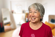 Baby Boomer Asian Woman at home.