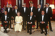 Heads of state of the G7 economic nations, including in the front row: President George Bush (Snr), Queen Elizabeth II, Francois Mitterrand, Helmut Kohl and at the back, centre, John Major - gather for an official portrait on 17th July 1991 at Buckingham Palace, London England.