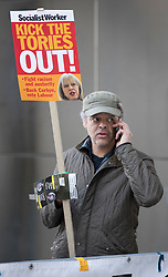 © Licensed to London News Pictures. 09/05/2017. London, UK. A protestors stands outside Broadcasting House as Prime Minister Theresa May and her husband Philip are driven in to to appear on the One Show. Mr and Mrs May are appearing together on the prime time show ahead of various appearances by all party leaders on TV in the run up to the general election on June 8, 2017. Photo credit: Peter Macdiarmid/LNP