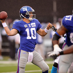 Quarterback Eli Manning #10 of the New York Giants passes during second half NFL action in the New York Giants' 31-18 victory over the Carolina Panthers at New Meadowlands Stadium in East Rutherford, New Jersey.
