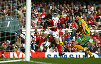 Photo. Chris Ratcliffe, Digitalsport<br /> Arsenal v Norwich City. Barclays Premiership. 02/04/2005<br /> Cesc Fabregas has a shot at goal as Jason Shackell of Norwich tries to close him down