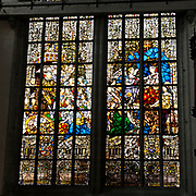 De Nieuwe Kerk is een kerkgebouw in Amsterdam. De kerk is gelegen aan de Dam, naast het Paleis op de Dam.De Nieuwe Kerk wordt, sinds soeverein-vorst Willem in 1814 in deze kerk de eed op de grondwet aflegde, ook gebruikt voor de inzegening van koninklijke huwelijken en voor inhuldigingen. De inhuldiging van Koningin Beatrix vond er plaats op 30 april 1980. Op dezelfde datum in 2013 zal de inhuldiging van haar zoon en opvolger Willem-Alexander ook daar plaatsvinden.<br /> <br /> The New Church is a church building in Amsterdam. The church is located on Dam Square, next to the Palace on the Dam.De New Church in this church in 1814, since sovereign-prince Willem laid aside the oath to the Constitution, also used for the blessing of royal weddings and inaugurations. The inauguration of Queen Beatrix took place on April 30, 1980. On the same date in 2013, the inauguration of her son and heir Willem-Alexander will also take place there.<br /> <br /> Op de foto / On the photo: Glas in Lood raam met links Willem van Oranje en recht Koningin Wilhelmina<br /> <br /> Stained Glass window with left and right William of Orange Queen Wilhelmina