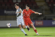 Bradford City midfielder Hope Akpan (21) and Leyton Orient's Conor Wilkinson(9) battles for possession during the EFL Sky Bet League 2 match between Leyton Orient and Bradford City at the Breyer Group Stadium, London, England on 24 November 2020.