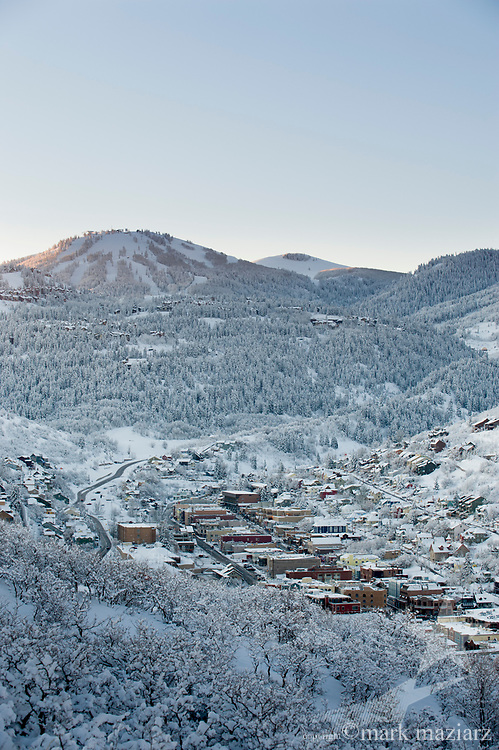 First rays of the sun hitting Deer Valley Resort's Bald Mountain over Old Town Park City, Utah, USA.