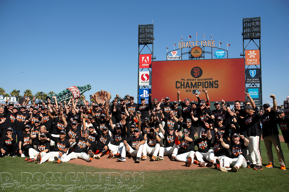 Oct 3, 2021; San Francisco, California, USA;  San Francisco Giants players and coaches pose for a group photo as they celebrate their 11-4 victory over the San Diego Padres at Oracle Park. The Giants clinched the National League West Division with the win. Mandatory Credit: D. Ross Cameron-USA TODAY Sports