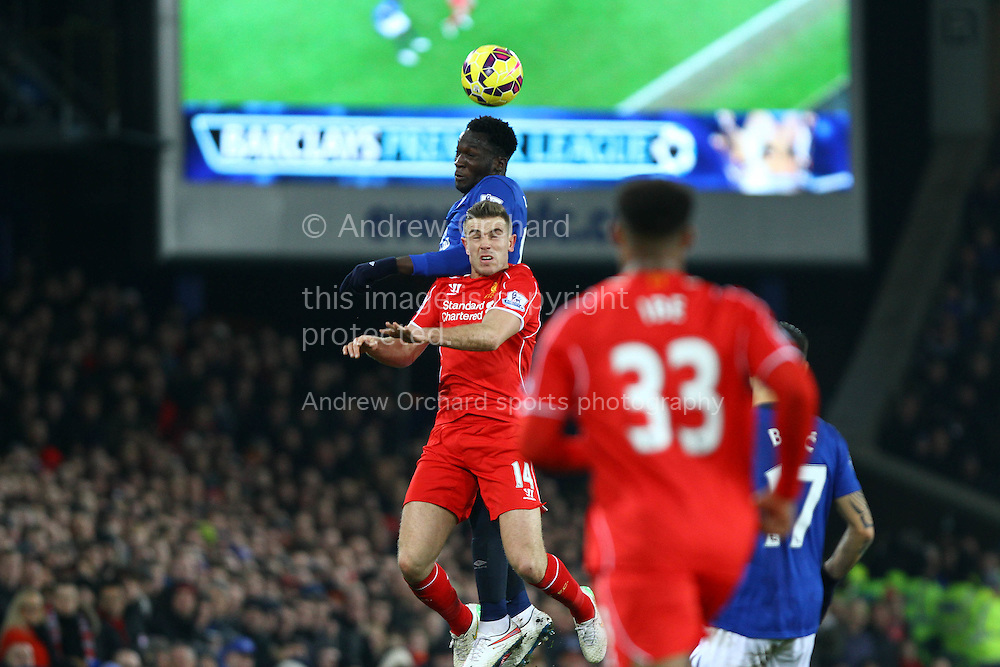 Romelu Lukaku of Everton and Jordan Henderson of Liverpool jump for the ball. Barclays Premier league match, Everton v Liverpool at Goodison Park in Liverpool, Merseyside on Saturday 7th February 2015<br /> pic by Chris Stading, Andrew Orchard sports photography.