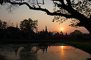The ruins of Wat Mahathat, or  'temple of the great relic', built from laterite and surrounded by a moat, are the centrepiece of the historic park of Sukhothai.