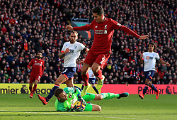 Bournemouth goalkeeper Artur Boruc claims the ball at the feet of Liverpool's Roberto Firmino during the Premier League match at Anfield, Liverpool.