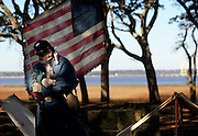 """A civil war re-enactor stands at attention at North Carolina's Fort Fisher during their reenactment of the """"Battle of Fort Fisher"""" on a cold January morning."""