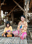 A mother and daughter who live in the floating village of Kompong Phluk on the great Tonlé Sap lake, Cambodia