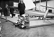 Prospective buyers discuss the catalogue at the RDS Boat Show. .10.03.1964