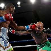 Cesar Francis (L) fights Gonzalo Dallera during a One For All Promotions boxing event at the Caribe Royale Orlando Events Center on Saturday, February 20, 2021 in Orlando, Florida. (Alex Menendez via AP)