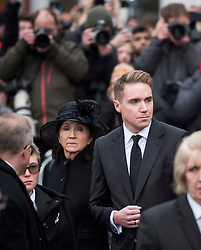 © Licensed to London News Pictures. 31/03/2018. Cambridge, UK. JANE HAWKING (former wife) and TIMOTHY HAWKING (son) watch as the coffin leaves The funeral of Stephen Hawking at Church of St Mary the Great in Cambridge, Cambridgeshire. Professor Hawking, who was famous for ground-breaking work on singularities and black hole mechanics, suffered from motor neurone disease from the age of 21. He died at his Cambridge home in the morning of 14 March 2018, at the age of 76. Photo credit: Ben Cawthra/LNP