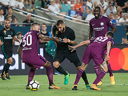 July 26, 2017 - Los Angeles, California, U.S - Karim Benzema #9 of Real Madrid drives thru Manchester City defenders during their International Champions Cup game at the Los Angeles memorial Coliseum in Los Angeles, California on Wednesday July 26, 2017. Manchester City defeats Real Madrid, 4-1. (Credit Image: © Prensa Internacional via ZUMA Wire)
