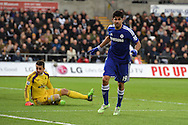 Diego Costa of Chelsea celebrates after he scores his teams 3rd goal, while Swansea keeper Lukasz Fabianski is left dejected.. Barclays Premier League match, Swansea city v Chelsea at the Liberty Stadium in Swansea, South Wales on Saturday 17th Jan 2015.<br /> pic by Andrew Orchard, Andrew Orchard sports photography.