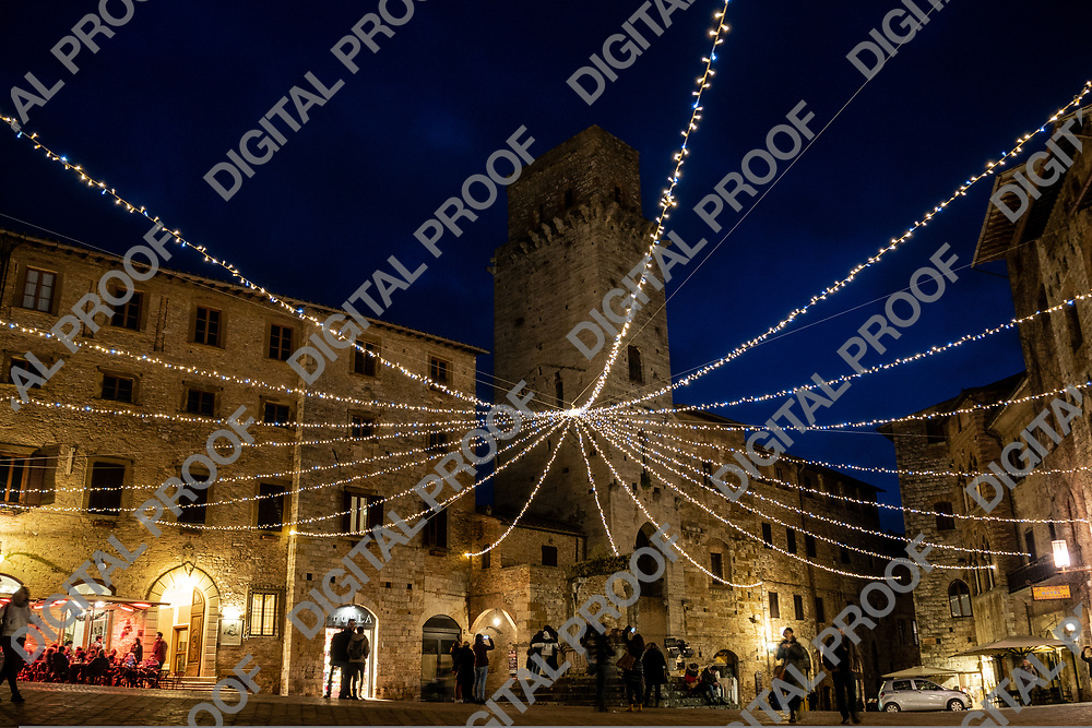 San Gimignano, Italy - December 29, 2018 Main Town square is illuminated with christmas lights