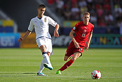 Italy's Alberto Grassi (left) and Czech Republic's Jakub Jankto battle for the ball
