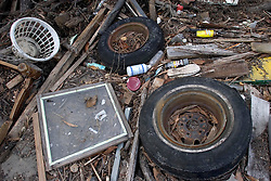 01 October, 05.  New Orleans, Louisiana. Lower 9th ward. Hurricane Katrina aftermath. <br /> The remnants of the lives of ordinary folks, now covered in mud as the flood waters recede. Debris lies washed up in a yard.<br /> Photo; ©Charlie Varley/varleypix.com