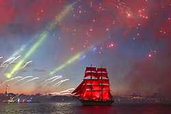 June 24, 2017 - Petersburg, Russia - A brig with scarlet sails floats on the Neva River as fireworks explode during the Scarlet Sails festivities marking school graduation. (Credit Image: © Irina Motina/Xinhua via ZUMA Wire)
