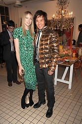 JADE PARFITT and ANDY WONG at a party to celebrate the 2nd issue of Distill Magazine held at The Shop at Bluebrid, Kings Road, London on 1st December 2008.