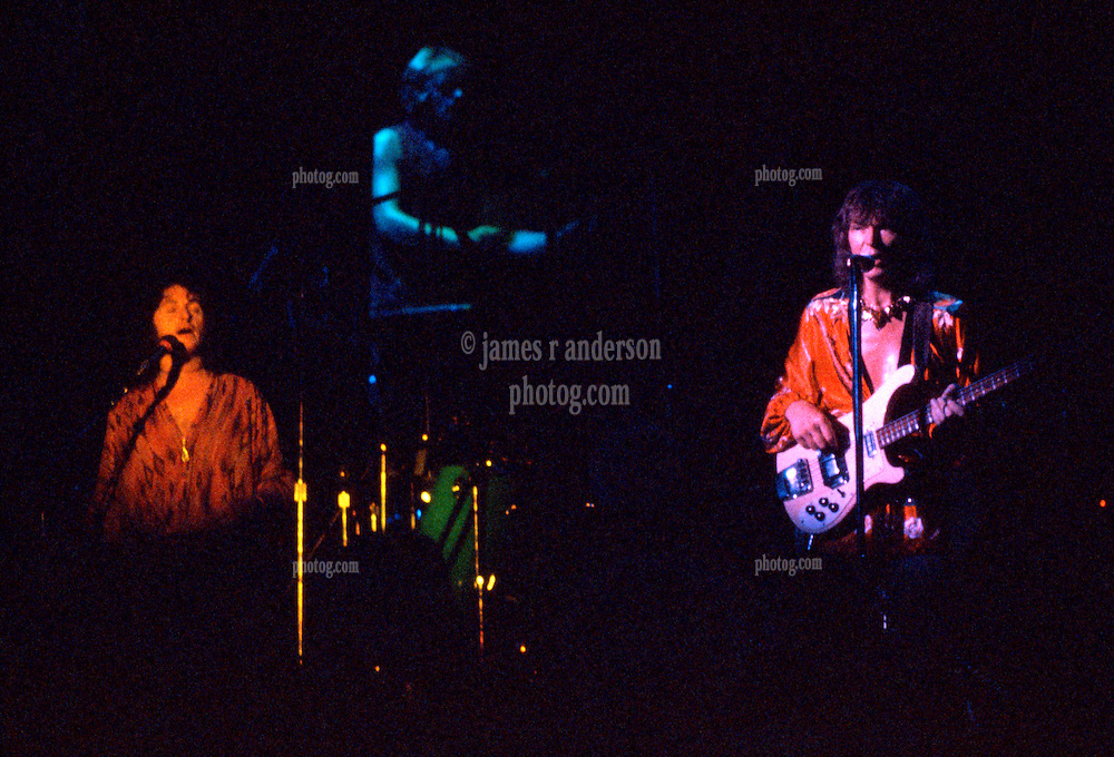 Yes performing at the New Haven Coliseum on 9 August 1977. L-R: Jon Anderson, Alan White & Chris Squire. Credit Photograph: James R Anderson, New Haven CT