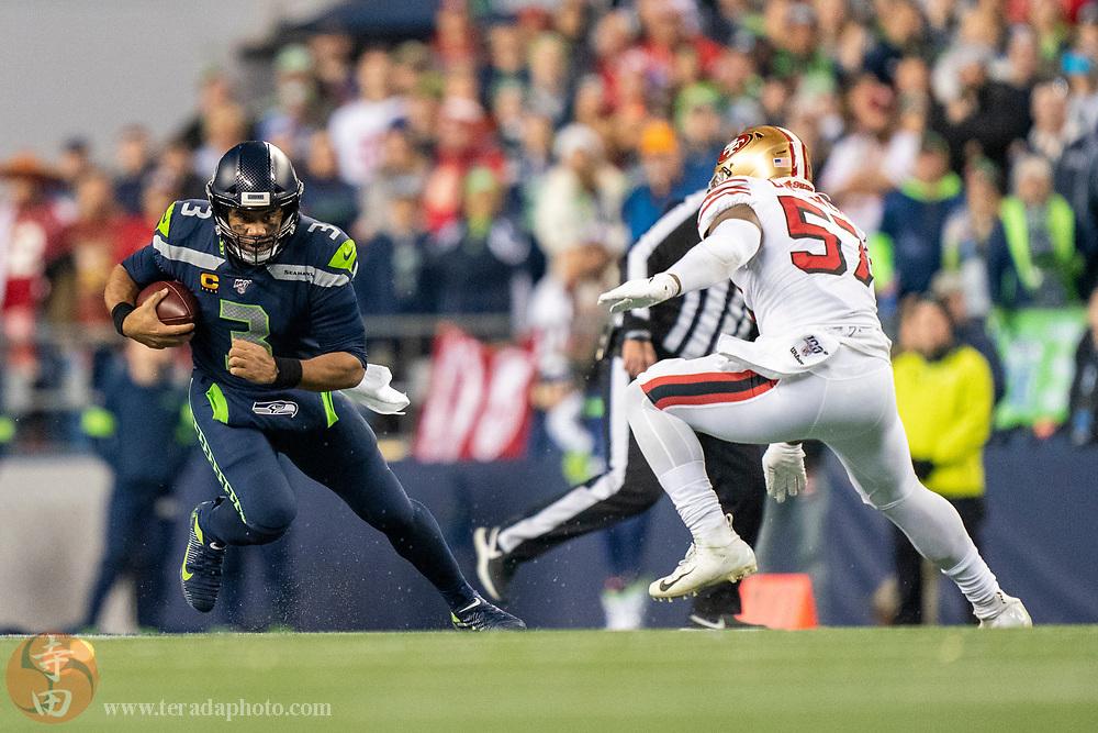 December 29, 2019; Seattle, Washington, USA; Seattle Seahawks quarterback Russell Wilson (3) runs against San Francisco 49ers linebacker Dre Greenlaw (57) during the second quarter at CenturyLink Field.