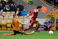 Middlesbrough striker Diego Fabbrini skips past Wolverhampton Wanderers midfielder Dave Edwards during the Sky Bet Championship match between Wolverhampton Wanderers and Middlesbrough at Molineux, Wolverhampton, England on 24 October 2015. Photo by Alan Franklin.