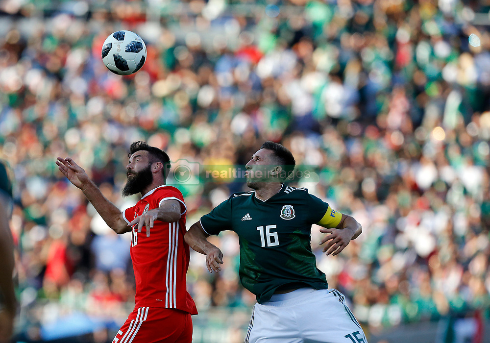 May 28, 2018 - Pasadena, CA, U.S. - PASADENA, CA - MAY 28: Joe Ledley of Wales battles HŽctor Herrera of Mexico for the ball during the game on May 28, 2018, at the Rose Bowl in Pasadena, CA.  (Photo by Adam  Davis/Icon Sportswire) (Credit Image: © Adam Davis/Icon SMI via ZUMA Press)