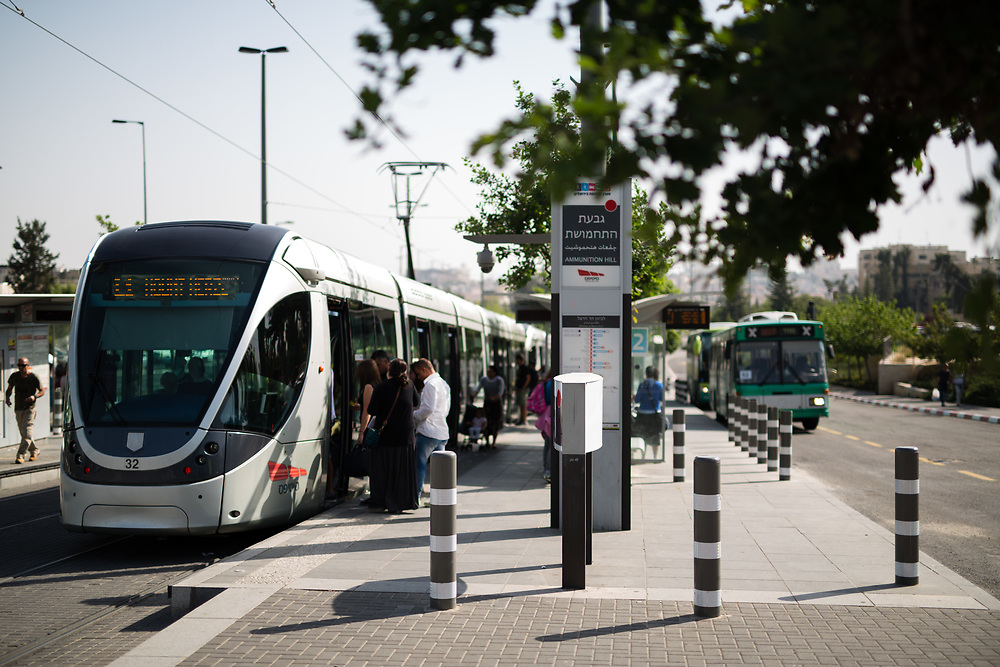 Passengers board a light rail tram, at the Ammunition Hill light rail stop in Jerusalem, Israel, on April 24, 2015.