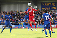 AFC Wimbledon defender Rod McDonald (26) battles for possession with Scunthorpe United attacker Lee Novak (17) during the EFL Sky Bet League 1 match between AFC Wimbledon and Scunthorpe United at the Cherry Red Records Stadium, Kingston, England on 15 September 2018.