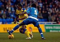 Photo: Daniel Hambury.<br />Reading v Cardiff City. Coca Cola Championship.<br />02/01/2006.<br />Reading's Ibrahima Sonko (R) trys to stop Cardiff's Cameron Jerome.