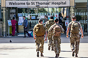British military personnel is seen outside St Thomas' Hospital in central London as British Prime Minister Boris Johnson is in intensive care fighting the coronavirus in London, Tuesday, April 7, 2020. British Prime Minister Boris Johnson was moved to intensive care after his coronavirus symptoms worsened. Johnson was admitted to St Thomas' hospital in central London on Sunday after his coronavirus symptoms persisted for 10 days. Having been in the hospital for tests and observation, his doctors advised that he be admitted to intensive care on Monday evening.. (Photo/Vudi Xhymshiti)