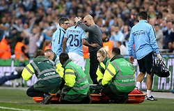 Manchester City's Fernandinho (centre) speaks to Manchester City manager Pep Guardiola as he comes off injured during the Carabao Cup Final at Wembley Stadium, London.