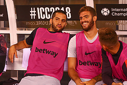 August 7, 2018 - East Rutherford, NJ, U.S. - EAST RUTHERFORD, NJ - AUGUST 07:  AS Roma defender Konstantinos Manolas (44) throws his sweatshirt on the head of AS Roma defender   Davide Stanton (18) up on the bench prior to the International Champions Cup game between Real Madrid and AS Roma on August 7, 2018, at Met Life Stadium in East Rutherford, NJ.  (Photo by Rich Graessle/Icon Sportswire) (Credit Image: © Rich Graessle/Icon SMI via ZUMA Press)