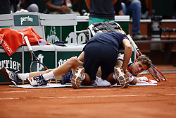 June 2, 2017 - Paris, France - Diego Schwartzman of Argentina receives treatment following an injury during mens singles third round match against Novak Djokovic of Serbia on day six of the 2017 French Open at Roland Garros on June 2, 2017 in Paris, France. (Credit Image: © Mehdi Taamallah/NurPhoto via ZUMA Press)