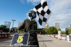 Super 73 electric bike races during the Revival and Roland Sands sponsored races set up in the parking lot of the Austin American Statesman outside the Handbuilt Show. Austin, Texas USA. Saturday, April 13, 2019. Photography ©2019 Michael Lichter.