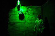 """A decapitated head and a man in a hazmat suit are part of Chris Baker's haunted yard display in South Yarmouth, MA. Every year Baker sets up an elaborate Halloween display in his yard and on Halloween, neighborohood residents walk through his frightening """"vortex"""" of horror while trick or treating."""