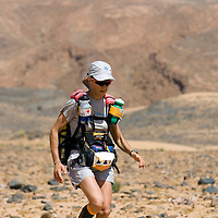 26 March 2007:  #229 Veronique Matur runs across a very rocky plain during the second stage (21.7 miles) of the 22nd Marathon des Sables between Khermou and jebel El Otfal. The Marathon des Sables is a 6 days and 151 miles endurance race with food self sufficiency across the Sahara Desert in Morocco. Each participant must carry his, or her, own backpack containing food, sleeping gear and other material.