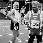 Senior athletes Svein Hoilo of Norway, rear, Hans Eberle of Germany, foreground left, and Attilio Jacquemet of Italy, foreground right, recover after running in the 80-84-year-old age division of the the 2007 World Masters Championships Stadia (track and field competition) at Riccione Stadium in Riccione, Italy on September 6-7, 2007. ..9,000 male and female athletes over the age of 35 from 90 countries competed in two weeks of track and field events at the 17th annual event. The event is run by  the World Association of Masters Athletes, the organization designated by the IAAF (The International Association of Athletics Federations) to conduct the worldwide sport of masters athletics. The organization runs competitions and maintains record standings in the 5-year increment age divisions.  ...