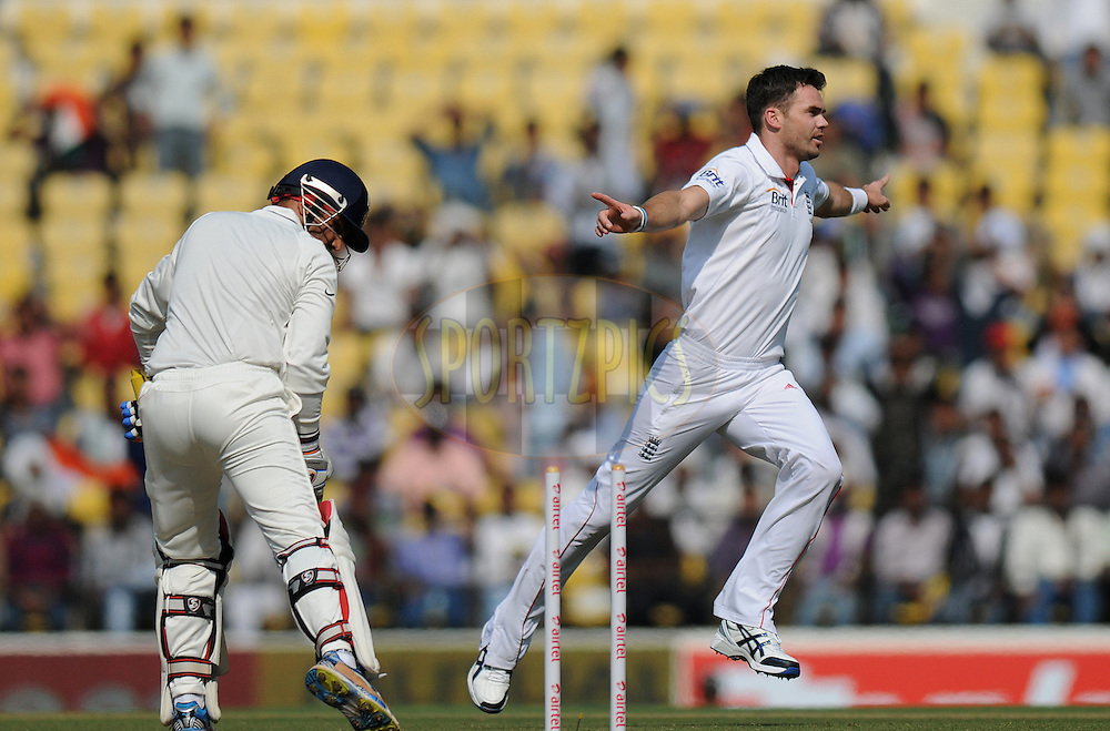 James Anderson of England celebrates after getting Virender Sehwag of India   bowled out as the latter looks on  during day two of the 4th Airtel Test Match between India and England held at VCA ground in Nagpur on the 14th December 2012..Photo by  Pal Pillai/BCCI/SPORTZPICS .